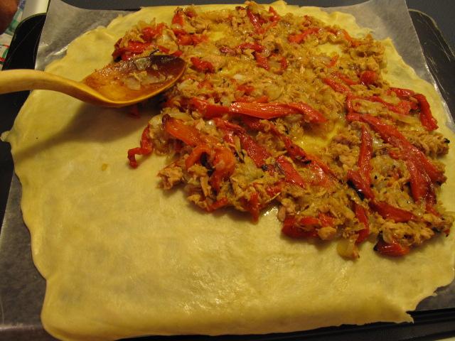 spreading out the filling for a Galician-style empanada, empanada gallega