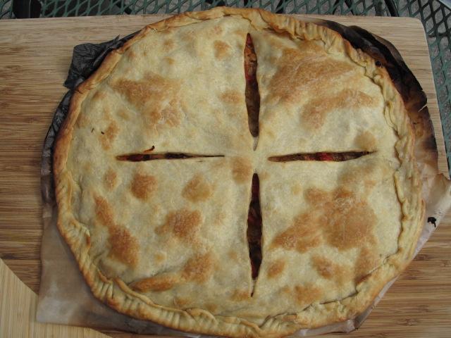 a Galician-style empanada, empanada gallega, fresh from the oven