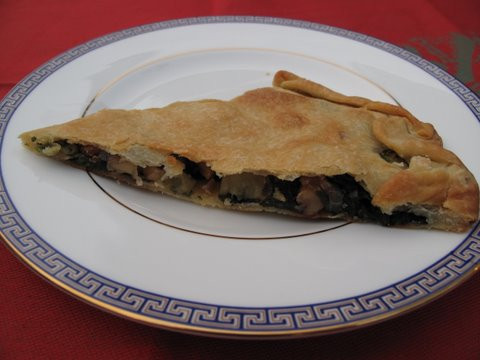 a tapa of spinach, apple, and walnut empanada