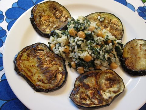 a plate of Spanish rice with chickpeas, spinach, and pan-grilled eggplant (arroz con garbanzos, espinacas, y berenjena)