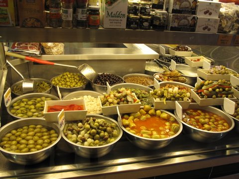 a stand selling olives in a Madrid market
