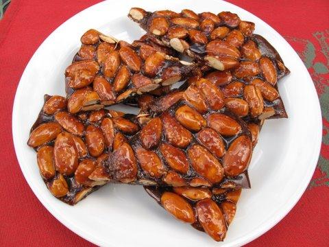 a plate of homemade turrón de guirlache, o tora de guirlache