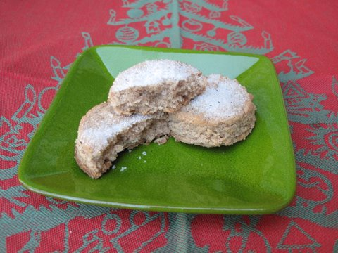 a small plate of Sevilla-style polvorones, a type of Spanish Christmas cookie