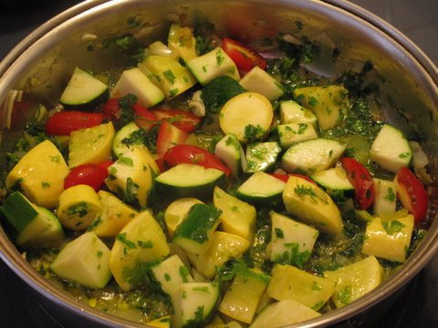 sauteing summer squash and other vegetables for a summer squash paella, arroz con calabacines