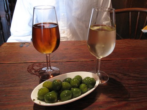 crisp, bright-green brined olives at La Venencia, a great old sherry bar in Madrid