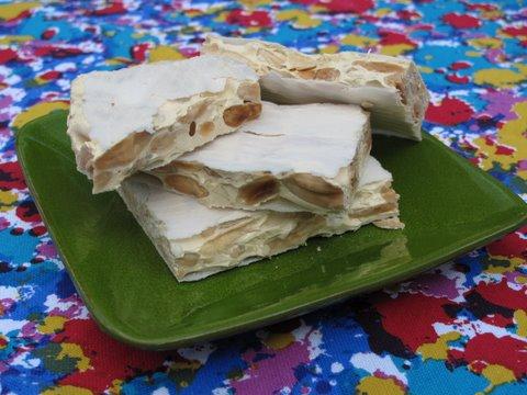 a small plate of turrón duro, torta imperial de almendres, turrón de Alicante