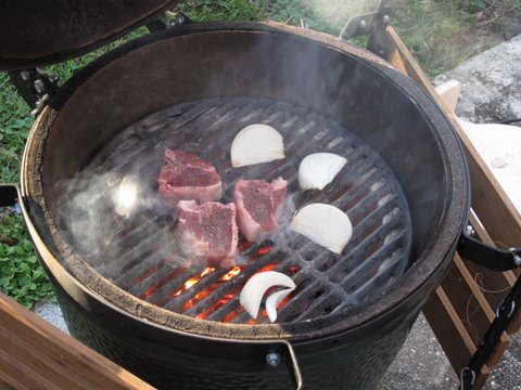 putting lamb chops (chuletas de cordero) on the kamado (Big Green Egg)
