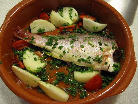 whole red snapper prepared for roasting