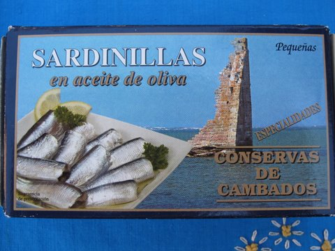 a tin of Galician sardinillas, small sardines, in olive oil