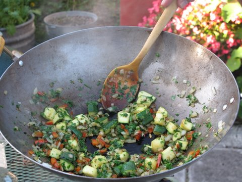 stir frying vegetables for a brown rice paella