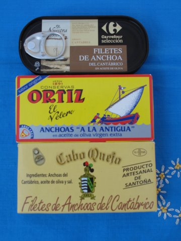 tins of Spanish anchovies, packed in olive oil