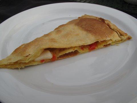 a slice of empanada de vieiras, scallop empanada