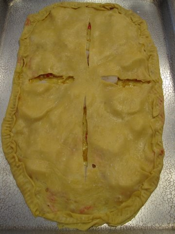 a empanada  assembled and ready to bake