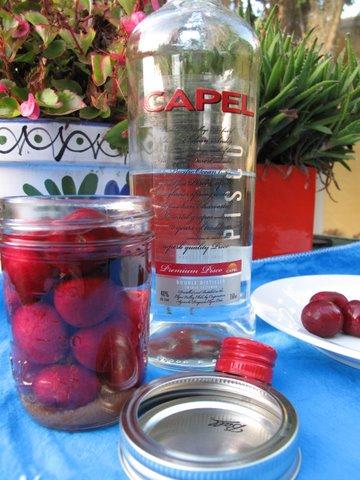 making Guindas al licor, cherries in pomace brandy