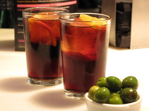 a complimentary tapa of campo real nueva olives at the vermouth bar in Madrid's Mercado de San Miguel