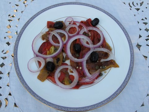 a salad of flame roasted peppers, onions, and olives