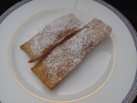 pestiños dusted with powdered sugar
