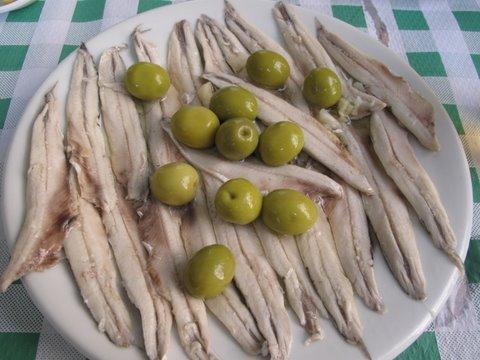 a tapa of boquerones en vinagre, fresh pickled anchovies