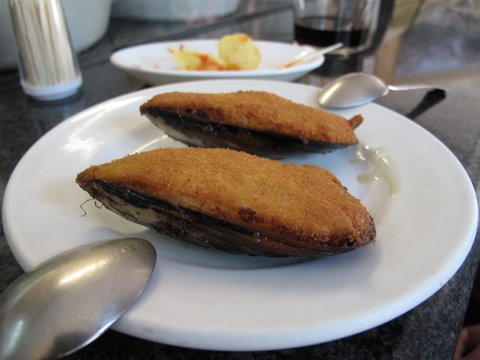 a tapa of mejillones tigres, mussel croquettes fried on the half shell