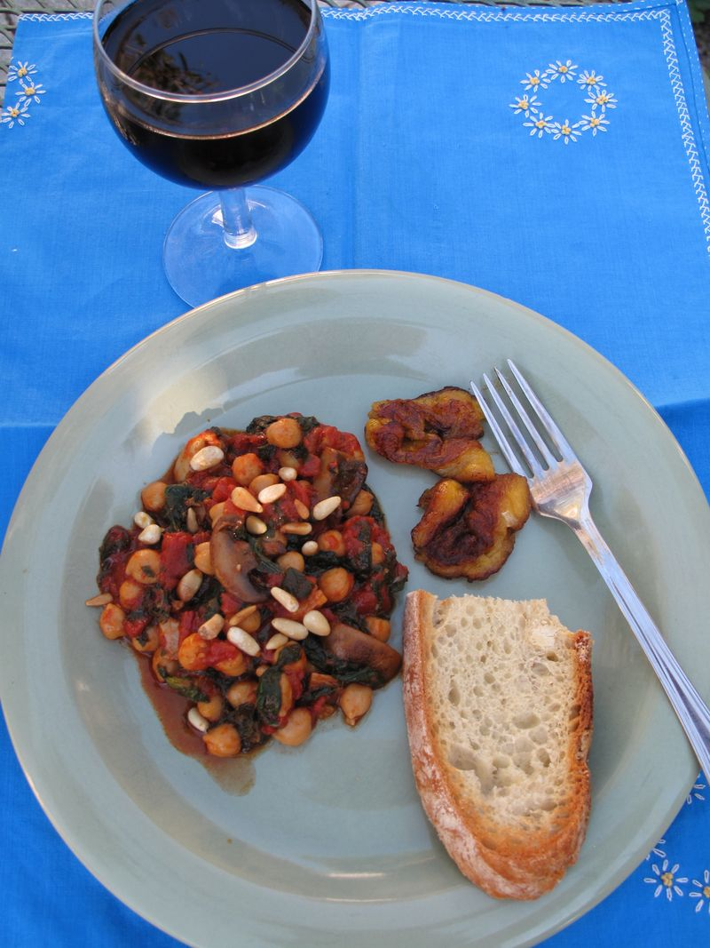hearty meal of tomatoes, garbanzos, spinach and mushrooms