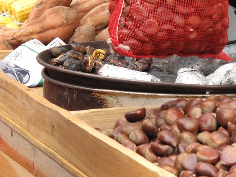 chestnuts and sweet potatoes roasting at a street stand