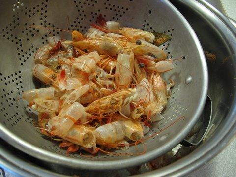straining shrimp broth